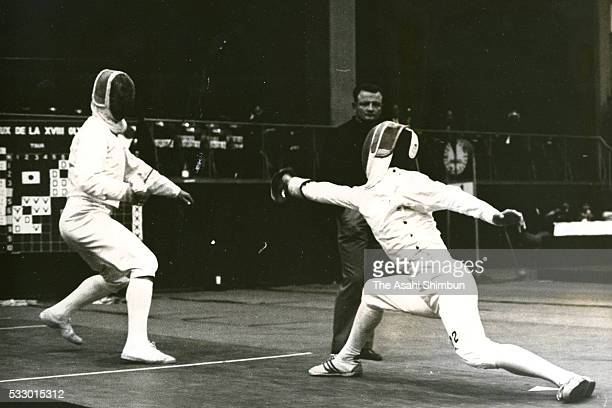 Teruhiro Kitao of Japan and Yakov Rylsky of the Soviet Union compete in the Fencing Men's Sabre Team Round One between Japan and soviet Union during...