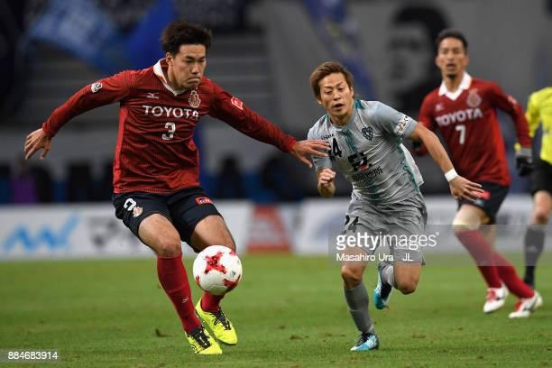 Teruhito Nakagawa of Avispa Fukuoka and Kazuki Kushibiki of Nagoya Grampus compete for the ball during the J.League J1 Promotion Play-Off Final...