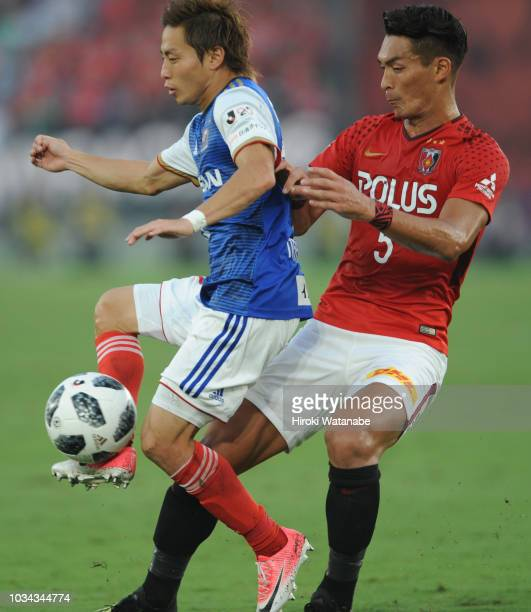 Teruhito Nakagawa of Yokohama FMarinos and Tomoaki Makino of Urawa Red Diamonds compete for the ball during the JLeague J1 match between Yokohama...