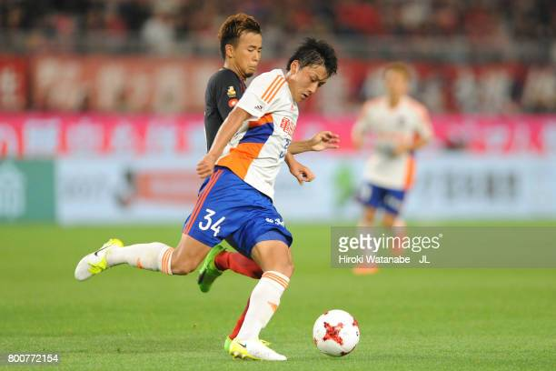 Teruki Hara of Albirex Niigata and Atsutaka Nakamura of Kashima Antlers compete for the ball during the JLeague J1 match between Kashima Antlers and...
