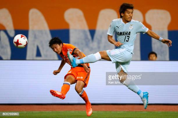Teruki Hara of Albirex Niigata and Tomohiko Miyazaki of Jubilo Iwata compete for the ball during the JLeague J1 match between Albirex Niigata and...