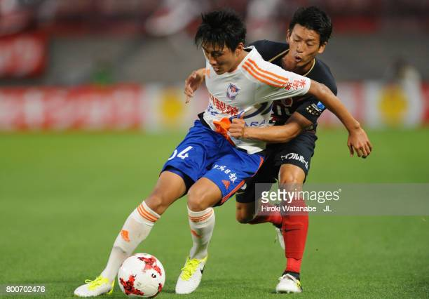 Teruki Hara of Albirex Niigata controls the ball under pressure of Shuto Yamamoto of Kashima Antlers during the JLeague J1 match between Kashima...