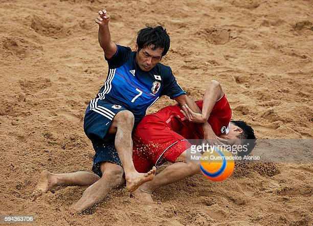 Teruki Tabata of Japan competes for the ball with Komkrit Nanan of Thailand during the Continental Beach Soccer Tournament match between Japan and...