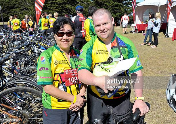 Terumi Irizawa and PJ White get their riding gear at the 15mile start of the Best Buddies Challenge Hearst Castle Carmel to San Simeon at Hearst...