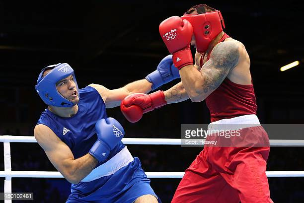 Tervel Pulev of Bulgaria competes against Oleksandr Usyk of Ukraine during their Men's Heavy Boxing bout on Day 14 of the London 2012 Olympic Games...