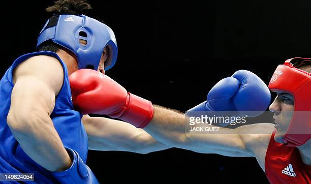 Tervel Pulev of Bulgaria defends against Xuanxuan Wang of China during their round of 16 Heavyweight boxing match of the London 2012 Olympics at the...