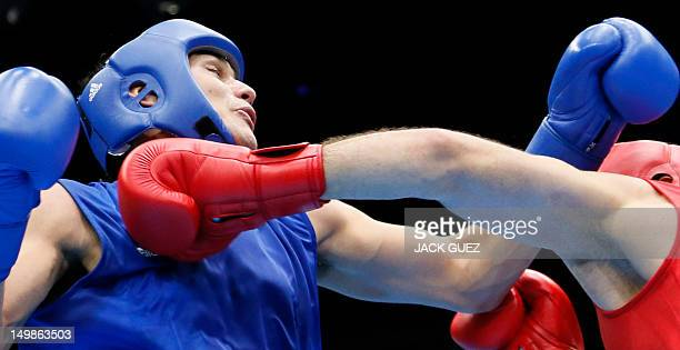Tervel Pulev of Bulgaria defends against Yamil Peralta Jara of Argentina during their quaterfinals Heavyweight boxing match of the 2012 London...
