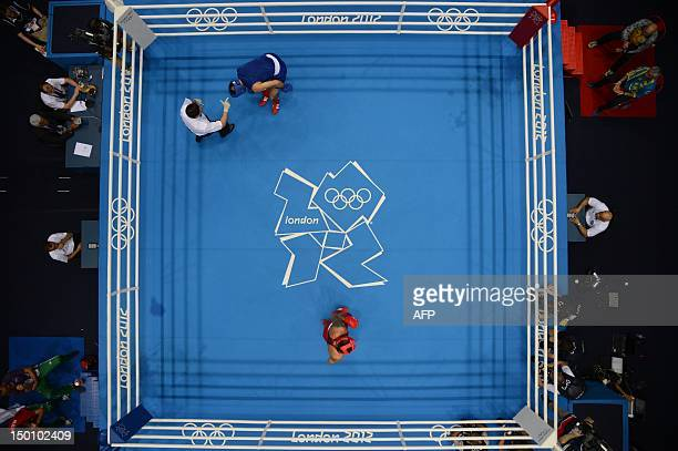 Tervel Pulev of Bulgaria takes a standing 8count after being decked by Oleksandr Usyk of the Ukraine during the men's Heavyweight boxing semifinals...