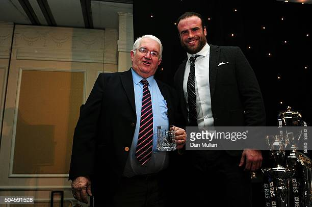 Terwyn Williams is presented with the Rugby Union Writers' Club Tankard Award by Jamie Roberts of Harlequins award during the Rugby Union Writers'...