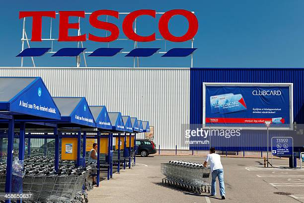 Tesco entrance with shopping carts.