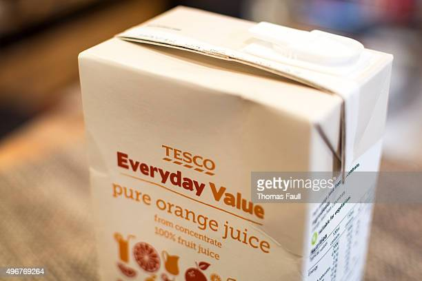 tesco everyday value orange juice - juice carton stock photos and pictures