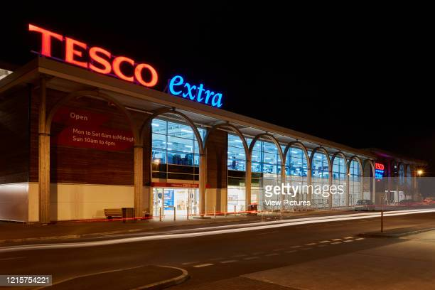 Tesco Extra entrance at night. Tesco Extra, Crewe, Crewe, United Kingdom. Architect: N/A, 2018..