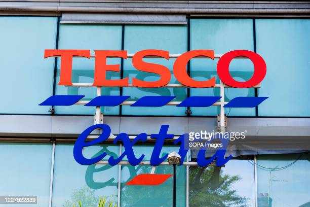 Tesco extra logo seen at one of their branches. Greenpeace has urged the supermarket giant to stop buying meat from the companies involved in Amazon...