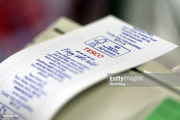 A Tesco logo sits on the back of a receipt at the Tesco Basildon Pitsea Extra supermarket operated by Tesco Plc in Basildon UK on Tuesday Dec 1 2015...