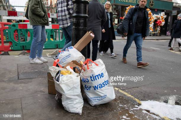 Tesco plastic carrier bags full of rubbish with the corporate slogan 'no time for waste' on 18th February 2020 in London England United Kingdom...