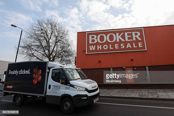 A Tesco Plc delivery van passes a Booker Wholesale warehouse operated by Booker Group Plc in London UK on Friday Jan 27 2017 Tesco Plc agreed to buy...