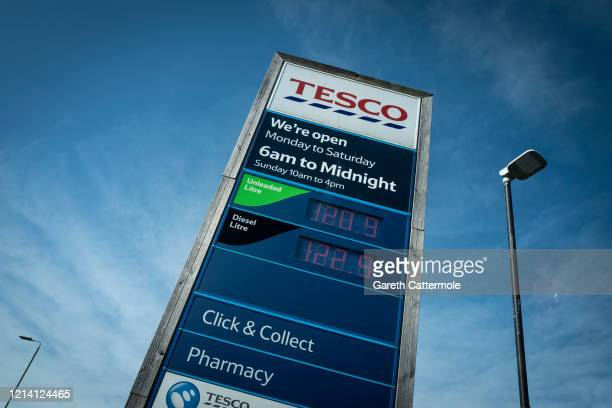 A Tesco sign directs to the price of Click and Collect petrol and the pharmacy as social distancing to stop the spread of the coronavirus prompts...