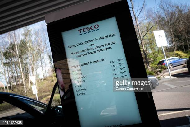 A Tesco sign notes the Click and Collect hours as social distancing to stop the spread of the coronavirus prompts different ways of shopping on March...