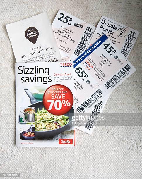 Tesco supermarket savings vouchers close up from above UK
