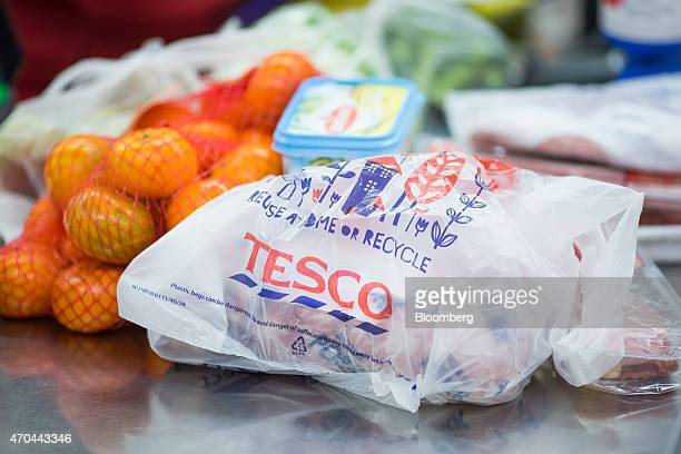 A Tescobranded plastic shopping bag sits on a checkout desk inside a Tesco supermarket operated by Tesco Plc in London UK on Monday April 20 2015...