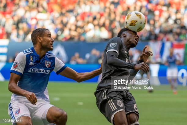 Tesho Akindele of FC Dallas and Alphonso Davies of the Vancouver Whitecaps at BC Place on September 23 2018 in Vancouver Canada
