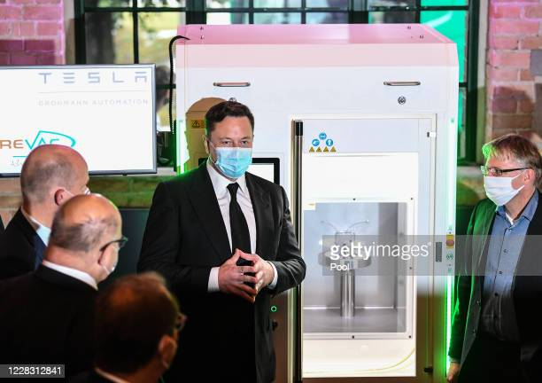 Tesla and SpaceX CEO Elon Musk presents a vaccine production device next to Christian Democratic Union and Christian Social Union faction leader in...