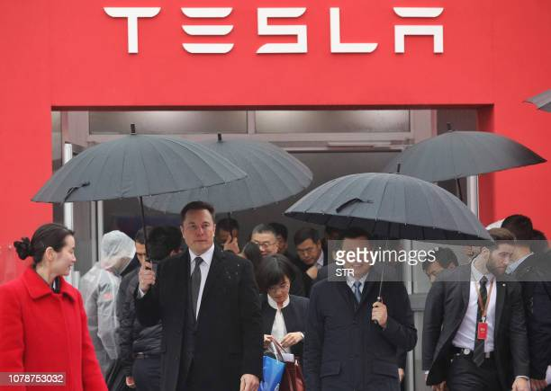 Tesla boss Elon Musk walks with Shanghai Mayor Ying Yong during the ground-breaking ceremony for a Tesla factory in Shanghai on January 7, 2019. -...