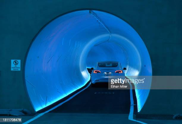 Tesla car drives through a tunnel in the Central Station during a media preview of the Las Vegas Convention Center Loop on April 9, 2021 in Las...