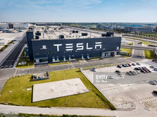 tesla car factory, shanghai - brand name stock pictures, royalty-free photos & images