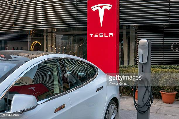 Tesla car is charging in a charging station Tesla's sales in China appear to be taking off EV sales in China have grown at a tripledigit clip...
