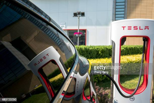 Tesla car is charging On May15 a Tesla super charging station located in Beijing Huamao center has been officially put into use It is equipped with...