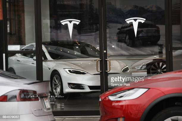 Tesla car is displayed in a showroom at a Brooklyn Tesla dealership on April 4 2017 in New York City As of Monday the startup car maker founded by...