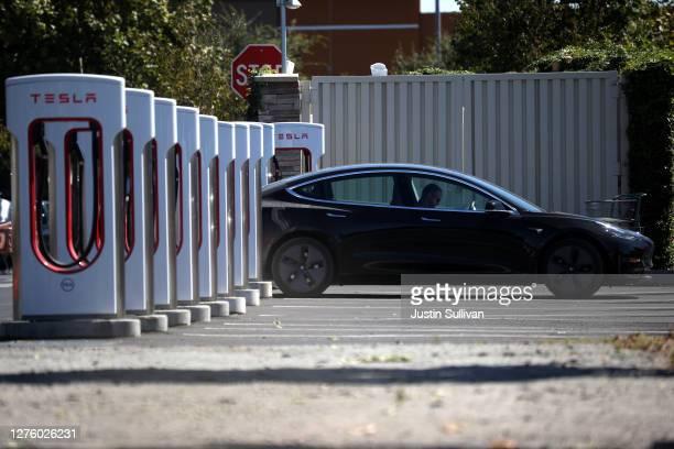 Tesla car sits parked at a Tesla Supercharger on September 23 2020 in Petaluma California California Gov Gavin Newsom signed an executive order...