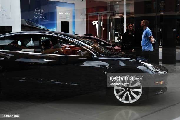 Tesla cars are displayed at a showroom in the Meatpacking district in Manhattan on June 6 2018 in New York City Tesla stock had its best day since...