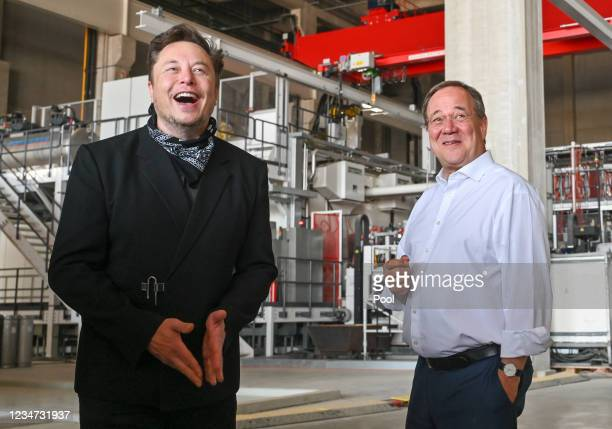 Tesla CEO Elon Musk and Armin Laschet, CDU Federal Chairman and Prime Minister of North Rhine-Westphalia, talk during a tour of the plant of the...