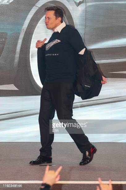Tesla CEO Elon Musk dances during the Tesla Chinamade Model 3 Delivery Ceremony in Shanghai Tesla CEO Elon Musk presented the first batch of...