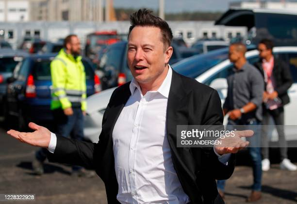Tesla CEO Elon Musk gestures as he arrives to visit the construction site of the future US electric car giant Tesla, on September 03, 2020 in...