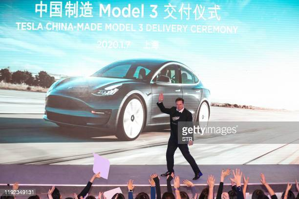 Tesla CEO Elon Musk gestures during the Tesla Chinamade Model 3 Delivery Ceremony in Shanghai Tesla CEO Elon Musk presented the first batch of...