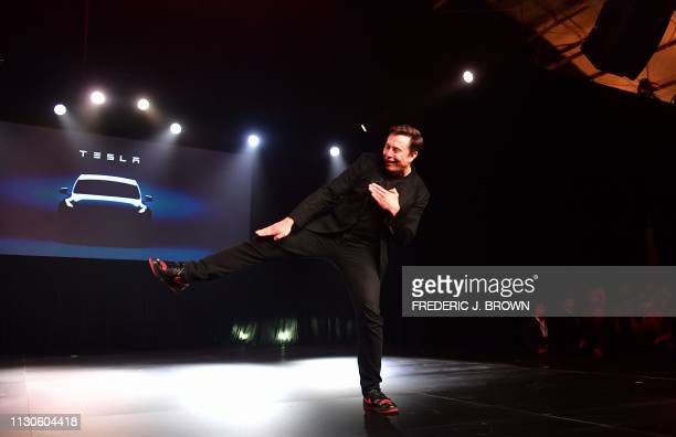 Tesla CEO Elon Musk gestures during the unveiling of the new Tesla Model Y in Hawthorne California on March 14 2019 Tesla introduced a new electric...