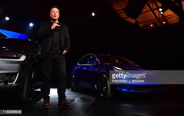Tesla CEO Elon Musk speaks beside the just unveiled new Tesla Model Y in Hawthorne California on March 14 2019