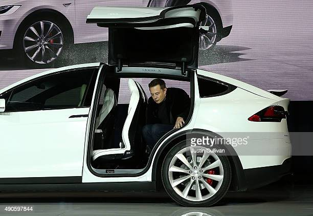 Tesla CEO Elon Musk steps out of the new Tesla Model X during an event to launch the company's new crossover SUV on September 29 2015 in Fremont...