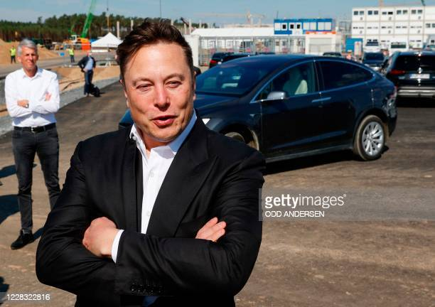 Tesla CEO Elon Musk talks to media as he arrives to visit the construction site of the future US electric car giant Tesla, on September 03, 2020 in...
