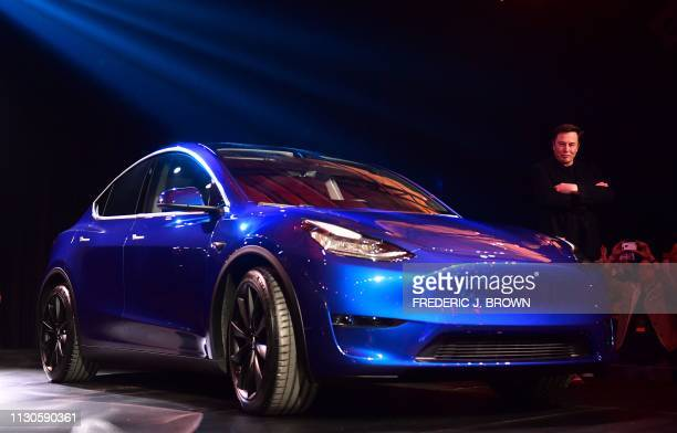 Tesla CEO Elon Musk views the new Tesla Model Y at its unveiling in Hawthorne California on March 14 2019
