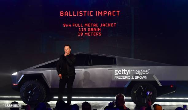 Tesla cofounder and CEO Elon Musk discusses ballistic impact in front of the newly unveiled allelectric batterypowered Tesla Cybertruck at Tesla...