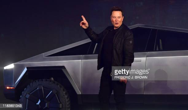 Tesla cofounder and CEO Elon Musk gestures while introducing the newly unveiled allelectric batterypowered Tesla Cybertruck at Tesla Design Center in...