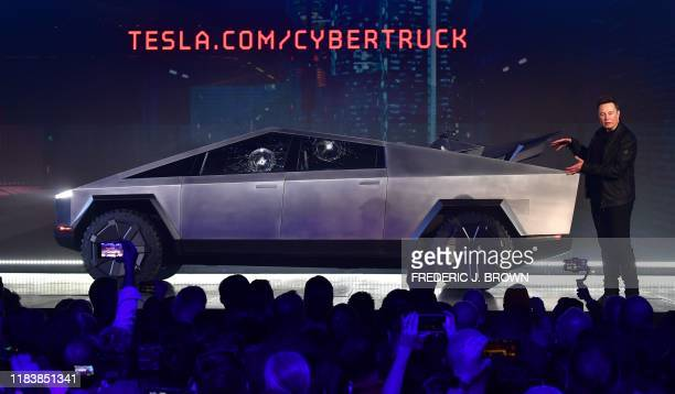 Tesla cofounder and CEO Elon Musk gestures while wrapping up his presentation of the newly unveiled allelectric batterypowered Tesla Cybertruck at...