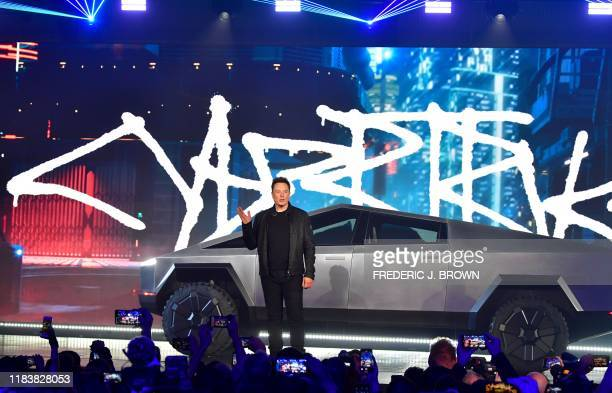 Tesla cofounder and CEO Elon Musk stands in front of the newly unveiled allelectric batterypowered Tesla's Cybertruck at Tesla Design Center in...