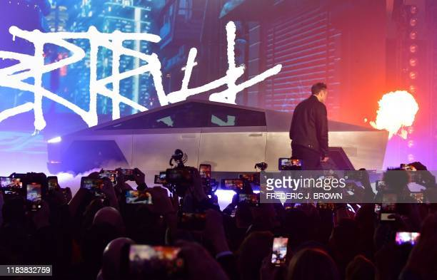 Tesla cofounder and CEO Elon Musk unveils the allelectric batterypowered Tesla's Cybertruck at Tesla Design Center in Hawthorne California on...