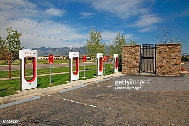 Tesla electric car charging station in a parking lot in Bozeman Montana Located in a hotel parking lot just of Interstate90 in Bozeman Montana