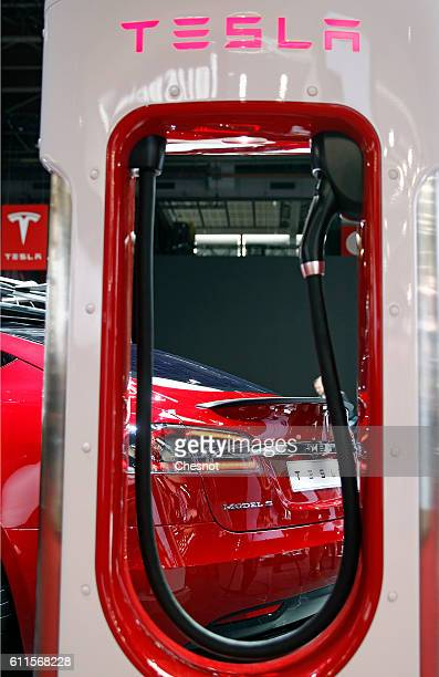 Tesla electric charger is displayed next to a Telsa model S car during the second press day of the Paris Motor Show on September 30 in Paris France...